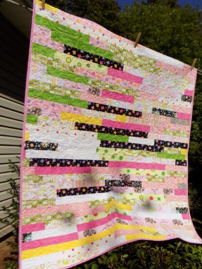 47 X 57 Jelly roll racing quilt