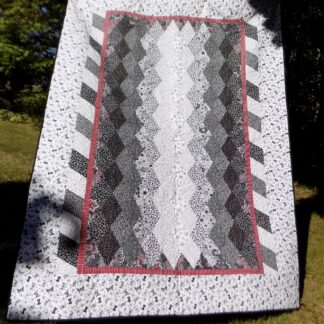 70 x 95.5 Black, white and red diamonds quilt